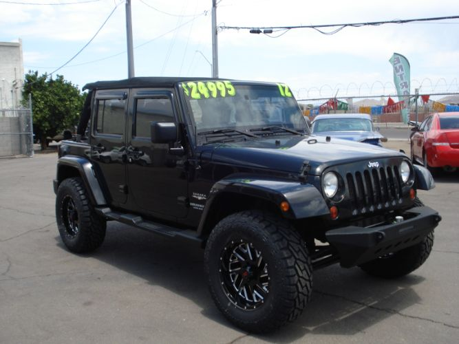 2012 Jeep Wrangler Unlimited Lifted 4 Door Sahara, Finance is Available