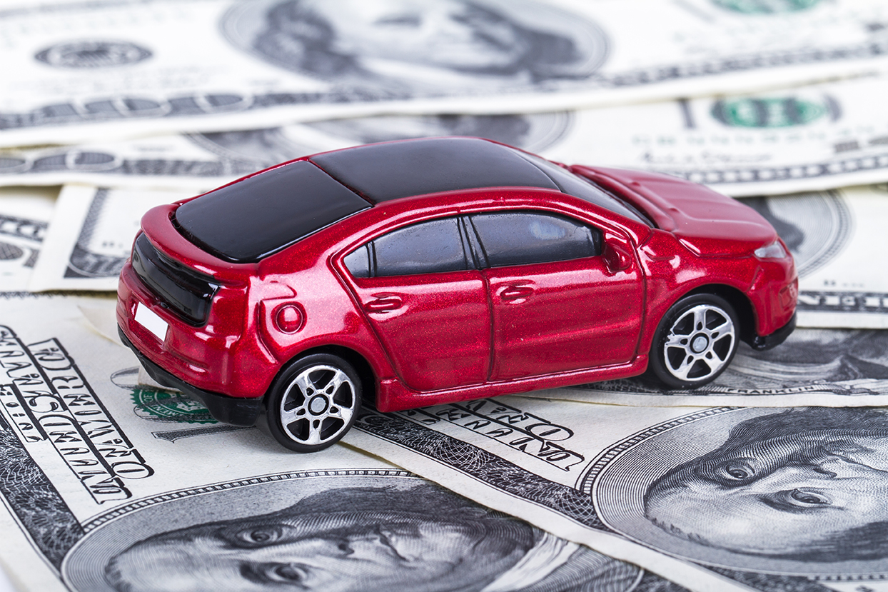 Car sales image with toy car and dollar bills